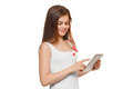 Attractive smiling girl in white shirt using tablet teenager with tablet pc isolated on white background Stock Photo