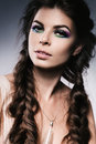 Attractive smiling woman with long braids in studio Stock Photo