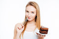 Attractive smiling young woman eating piece of chocolate cake