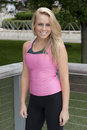 Attractive sports model a young blonde woman ready to exercise in her nike clothing Stock Image