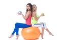 Attractive sportswomen sitting on gymnastic ball image of big Stock Photography