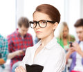 Attractive student wearing glasses in college Stock Images