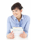 Attractive student woman with stack of books Stock Photos