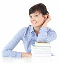 Attractive student woman with stack of books Royalty Free Stock Images