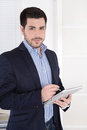 Attractive successful manager with digital tablet at office portrait of a modern young businessman pc in the Stock Photography