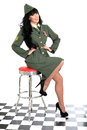 Attractive supportive charitable young vintage pin up model in military uniform or helpful woman the royal navy with long black Royalty Free Stock Photo
