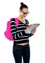 Attractive teenager working on tablet pc Stock Photo