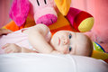 Attractive tired baby cute lies on the wite pillow Royalty Free Stock Photo