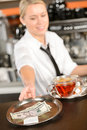 Attractive waitress taking tip in bar usd from tray american dollar Stock Photos