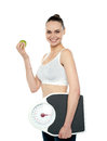 Attractive woman with apple and weight scale Stock Photo