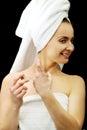 Attractive woman applying parfume.