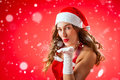 Attractive woman as Santa Claus blowing snow Royalty Free Stock Photo