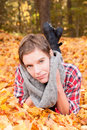 Attractive woman in autumn leaves Stock Image