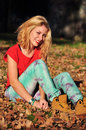 Attractive woman in autumn park modern young forest or woods Royalty Free Stock Photo