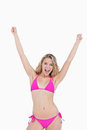 Attractive woman in beachwear raising her arms Royalty Free Stock Images