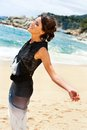 Attractive woman in black dress enjoying sea breeze portrait of elegant brunette smart Royalty Free Stock Photo