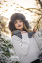 Attractive woman with black fur cap and gray shawl enjoying the winter. Frontal view of fashionable brunette girl with makeup Royalty Free Stock Photo