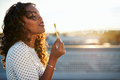 Attractive woman blowing bubbles Royalty Free Stock Photo