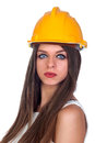 Attractive woman with blue eyes and yellow helmet Royalty Free Stock Images