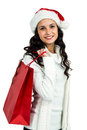 Attractive woman with christmas hat holding red shopping bag on white screen Stock Image