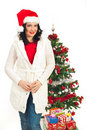 Attractive woman with Christmas tree Royalty Free Stock Images