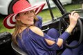 Attractive woman in classic car wealthy exits her sports Stock Photos