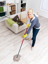 Attractive woman cleaning in her house Royalty Free Stock Photography