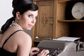 Attractive woman/clerk with typewriter - retro Royalty Free Stock Image
