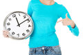 Attractive woman with a clock. Close up. Bodypart. Royalty Free Stock Photo