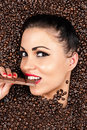 Attractive woman in a coffee beans with chocolate hand Stock Photography