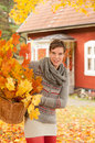 Attractive woman collecting autumn leaves Stock Photo