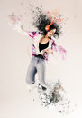Attractive woman dancing to her music energetic young asian with hair flying and a colorful splash effect on arms feet and Royalty Free Stock Image