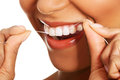 Attractive woman with dental floss closeup mouth and teeth on white Stock Photo