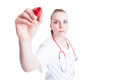 Attractive woman doctor holding a marker in her hand