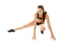 Attractive woman doing stretching athletic young up her legs isolated on white background Royalty Free Stock Photo