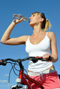 Attractive woman drinking cold water Stock Photography
