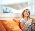 Attractive woman drinking refreshment outdoors closeup portrait of an Royalty Free Stock Photos