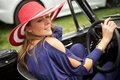 Attractive woman driving a classic car wealthy exits her sports Stock Photo