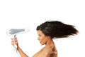 Attractive woman drying her hair. Royalty Free Stock Photo