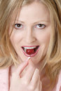 Attractive woman eating a cherry Stock Photos