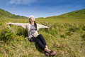 Attractive woman enjoying fresh air young on green hills Stock Images