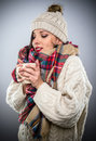 Beautiful Woman in Winter Clothes blowing