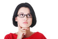 Attractive woman in eyeglasses is looking up and thinking isolated on white Stock Image