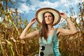 Attractive woman farmer in the cornfield sexy standing at harvest Stock Photos