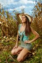 Attractive woman farmer in the cornfield sexy standing at harvest Royalty Free Stock Photography