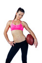 Attractive woman with football posing Stock Photography