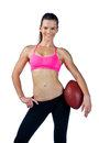 Attractive woman with football posing Stock Photos