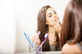 Attractive woman getting ready for a date portrait of beautiful young putting some lipstick on and to go out on at night Stock Photos