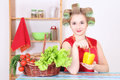 Attractive woman with hair curlers in the kitchen Stock Photo