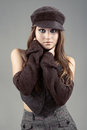 Attractive woman hat grey background Royalty Free Stock Image